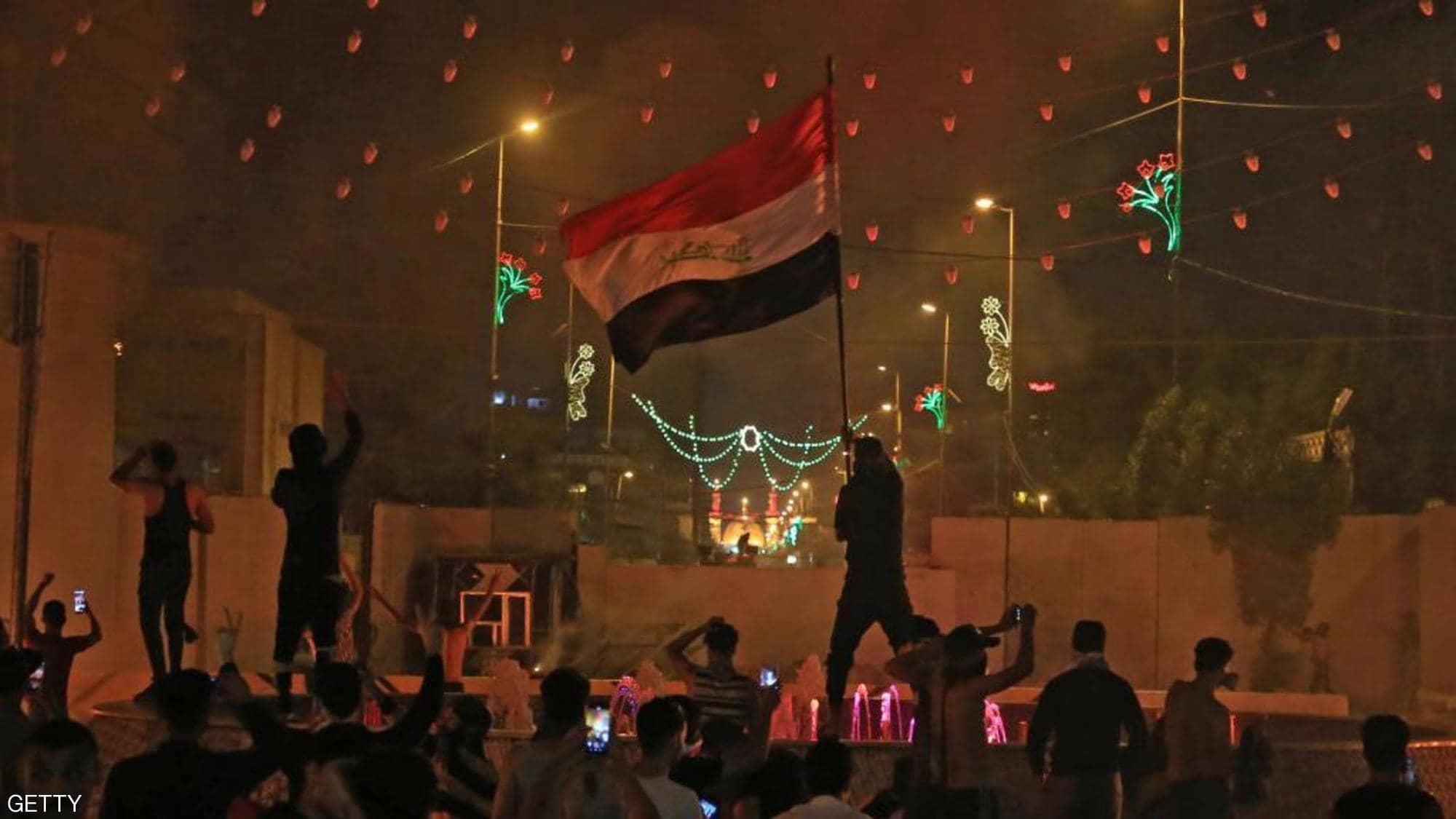Iraqi protesters surround the Iranian consulate in Karbala.