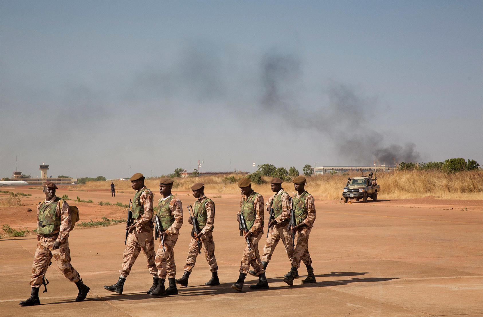 Malian soldiers patrol an airbase in Bamako, Mali, Jan. 16, 2013. (Marco Gualazzini/The New York Times)