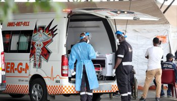 Health workers chat near an ambulance at the parking lot of the Steve Biko Academic Hospital, amid a nationwide coronavirus disease lockdown, in Pretoria on January 11, 2021. Picture: REUTERS/SIPHIWE SIBEKO
