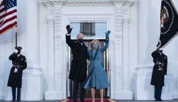 U.S. President Joe Biden and first lady Jill Biden wave as they arrive at the North Portico of the White House, Wednesday, Jan. 20, 2021, in Washington. (AP Photo)