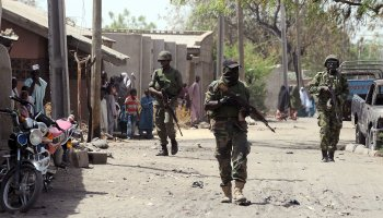 This file photo shows Nigerian troops patrolling the streets of the remote northeastern town of Baga, Borno State, Nigeria, April 30, 2013. (AFP Photo)