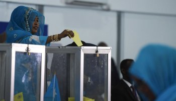 UN Photo/Ilyas Ahmed A Member of Parliament from the Somalia Federal Parliament casts her ballot during the first round of the 2017 presidential election (file photo).