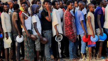 Ethiopian men who fled war in Tigray region, queue for wet food ration at the Um-Rakoba camp, on the Sudan-Ethiopia border in Al-Qadarif state, Sudan November 19, 2020. (Reuters)