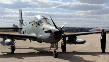 © EVARISTO SA A Super Tucano aircraft on display during a defense fair at Brasilia's Air Base in 2012
