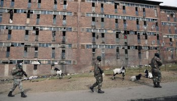 South African Defence Force soldiers on patrol alongside the male single sex hostels in Alexandra Township, north of Johannesburg, Thursday, July 15 2021. The army has begun deploying 25,000 troops to assist police in quelling the weeklong riots and violence sparked by the imprisonment of former President Jacob Zuma. (AP Photo)